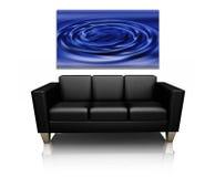 Sofa avec l'art de toile Photographie stock