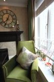 Sofa avec l'oreiller par l'hublot Images libres de droits