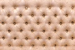Sofa back upholstered in fabric as background and texture stock photography