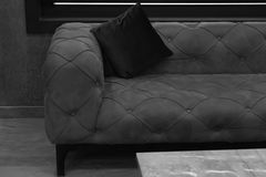 Sofa and backrest pillow. Black and white image of vintage sofa with backrest pillow in room Stock Image