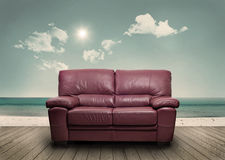 A sofa on the beach Royalty Free Stock Photography