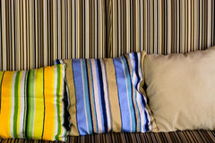 Sofa with beautiful colourful pillows. In the room Royalty Free Stock Images