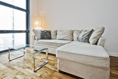 Sofa bed. Living room with gray sofa bed and floor to ceiling window Stock Images