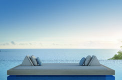 Sofa bed with sea view swimming pool in luxury beach hotel Royalty Free Stock Image