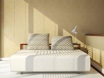 Sofa-bed on tan wall Stock Photos