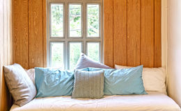 Sofa bed in wooden cottage style room Royalty Free Stock Images