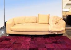 Sofa beige Photographie stock libre de droits