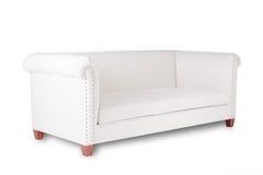 Sofa blanc simple sur un fond blanc Photographie stock