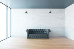 Sofa and blank brick wall. Interior with leather sofa, blank brick wall and wooden floor. Mock up, 3D Rendering Stock Images