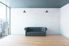 Sofa and blank wall Stock Photography