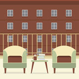 Sofa With Books And Coffee no balcão Foto de Stock Royalty Free