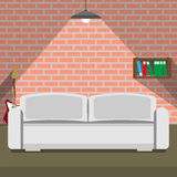 Sofa on the brick wall background. loft style.  Royalty Free Stock Images