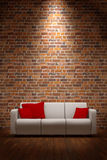 Sofa with brickwall Royalty Free Stock Photos