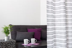 Sofa with bright cushions in a living room Stock Image