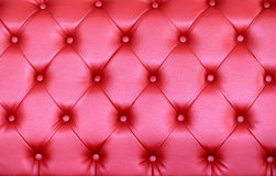Tufted Leather Texture Vintage pink sofa surface. stock photos