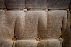 Sofa with a buttons. Background Stock Images
