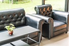 Sofa and chair interior decoration. In living room Royalty Free Stock Images