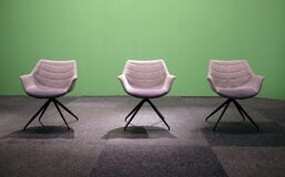 Sofa chairs under the lights against a green screen in the studio