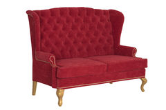 Sofa Chesterfield from a red velvet Royalty Free Stock Photos