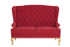 Sofa Chesterfield from a red velvet Stock Images
