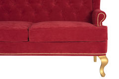 Sofa Chesterfield from a red velvet Royalty Free Stock Images