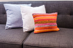 Sofa with colourful pillows. Interior design with couch, sofa with colourful designer cushions, pillows Royalty Free Stock Image