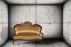 Sofa on concrete indoor backdrop Royalty Free Stock Image