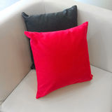 Sofa corner with red and gray cushions Royalty Free Stock Photo