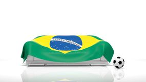 Sofa covered with Brazilian flag. And classic soccer ball Stock Photos