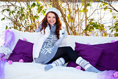 Sofa, cup of tea and woman in winter day Royalty Free Stock Photo