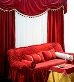 Sofa with curtains. Old style interior with big red sofa and curtains Stock Photos