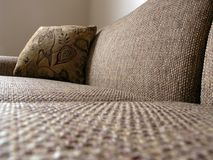 Sofa and Cushion 2. A new sofa and cushion in a freshly painted home Royalty Free Stock Image