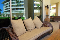 Sofa with cushion on terrace of summer resort. Wicker outdoor sofa with cushion on terrace of summer luxury resort Royalty Free Stock Photography