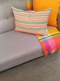 Sofa and cushions in gray and orange tones Royalty Free Stock Photo