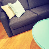 Sofa with cushions and green coffee table Royalty Free Stock Images