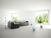 Sofa with cushions. In a large room Royalty Free Stock Images