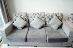 Sofa with cushions in living room Stock Photos