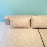 Sofa with cushions near green wall Royalty Free Stock Photography