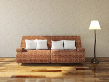 Sofa with cushions. Near the wall Royalty Free Stock Image
