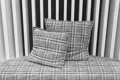 Sofa with cushions and wall in black and white Stock Photography