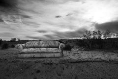 Sofa in the desert. Sofa outside in the Desert Landscape Stock Photo