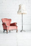 Sofa with desk lamp in vintage room. Pink classical style Armchair sofa couch in vintage room with desk lamp Royalty Free Stock Photography