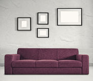 Sofa and empty frames Stock Photography