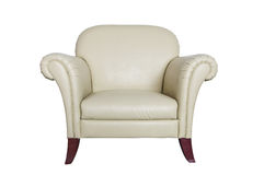 Sofa en cuir crème sur un fond blanc. Photographie stock libre de droits