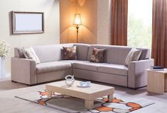 Sofa faisant le coin pour la maison image stock