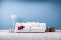 Sofa and floor lamp at blue wall