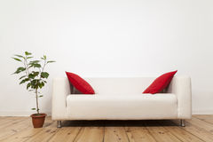 Sofa and flower pot Royalty Free Stock Photos