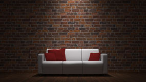 Sofa in front of brick wall Royalty Free Stock Image