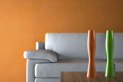 Sofa and Furniture against Orange Wall Stock Photos