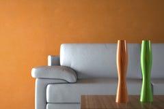 Sofa and Furniture against Orange Wall Stock Photos